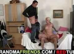 Old blond takes two cocks...