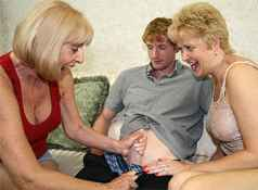 Two granny's named Scarlet and Tracy give a blowjob to a veryt large and young cock....